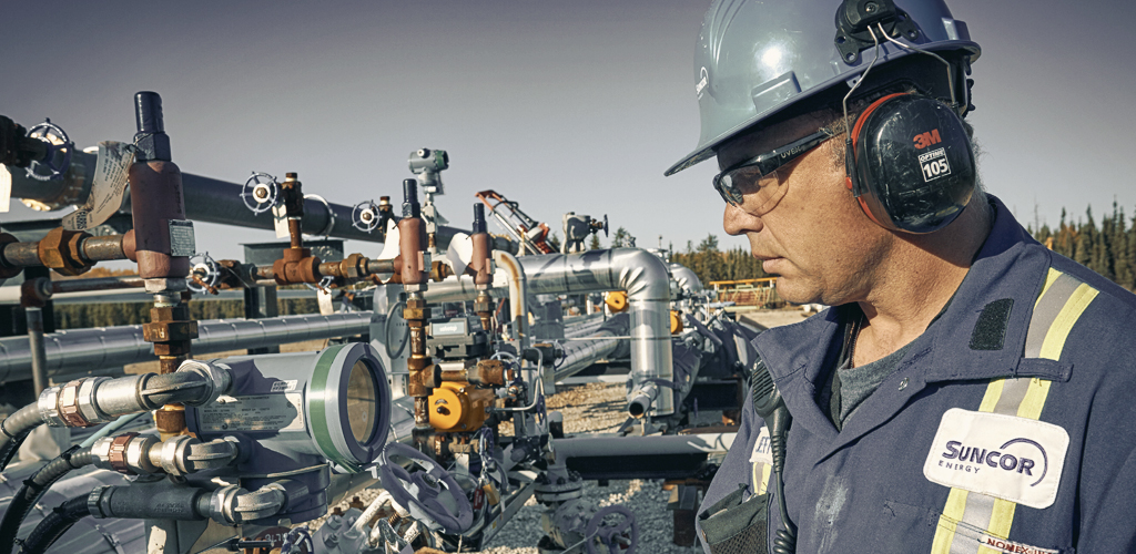 A Suncor operator checks a valve on the ESEIEH pilot at its Dover site, north of Fort McMurray.